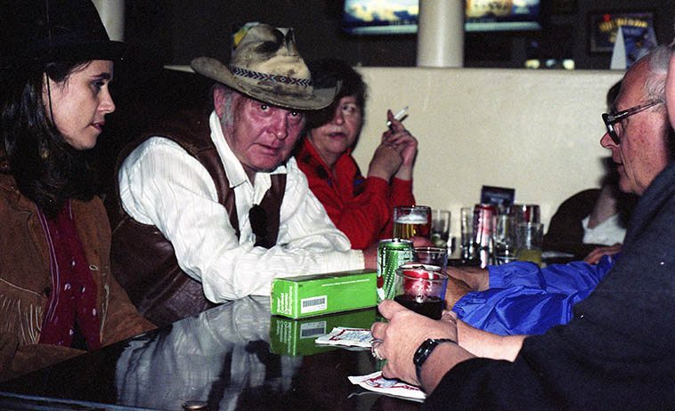 Kell Robertson at the Silver Dollar Saloon in Raton, New Mexico -- June 20, 1992 -- that's his wife Betsy with cig, and Mary Evans on his right, and Todd Moore across the table from him -- photo by Mark Weber