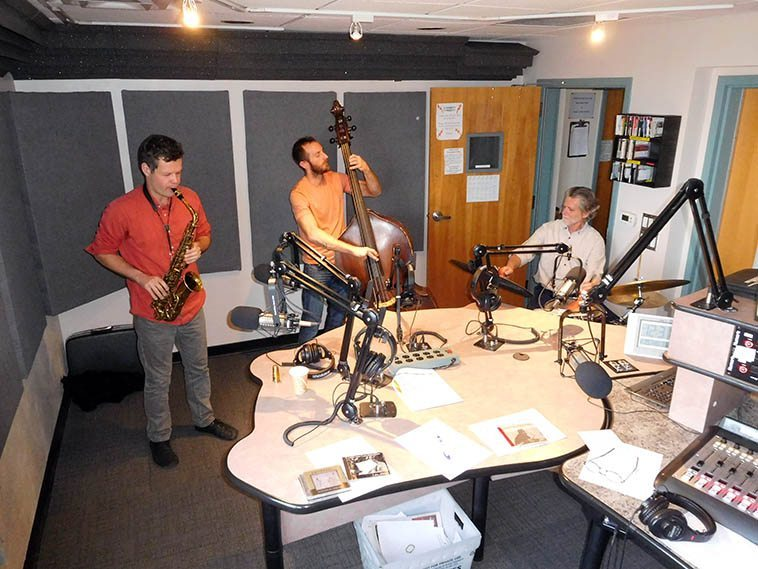The Nick Lyons New Mexico Trio -- December 29, 2o16 -- digital snapshot by Mark Weber -- KUNM control room broadcasting Live over the New Mexico airwaves, these guys played their tails off, fleet, and lyrical, pulsing with rhythm -- A return engagement as Nick has family in New Mexico and visits every year or so, the first time this trio played on the Thursday jazz show was July 31, 2008 ----- The December 29 show will be on the KUNM archive for 2 weeks, check it out -- Colin Deuble (bass), Cal Haines (drums), Nick Lyons (alto)