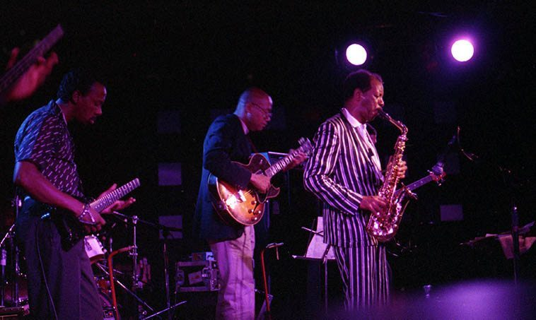 Ornette Coleman & Primetime -- June 27, 1986 at Wolfgang's, Columbus Avenue, San Francisco -- Charles Ellerbee & Bern Nix (guitars), Jamaaladeen Tacuma & Al MacDowell basses) -- photo by Mark Weber