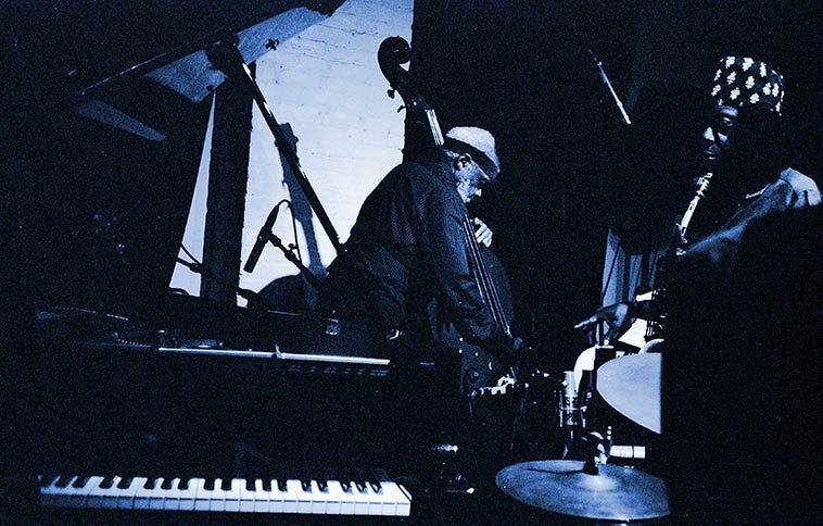 Henry Grimes with the Jameel Moondoc Quartet (including Connie Crothers & Chad Taylor) at The Stone -- September 19, 2009 -- photo by Mark Weber -- I know this band recorded some of their performances (this one for one), I sure wish they'd make the sounds available, there has never been someone like Connie who was so attuned to what Henry was all about ----- I had a major epiphany the other afternoon listening to Henry Grimes: ominous dark clouds engulfing New Mexico (I love this time of year -- good for fires in the fireplace and reading anthropology) -- when Henry read one of his poems then picked up the bass and hooked into the cosmos the way he does so naturally I felt I understood him on a whole new level (cd SPIRITS ALOFT in duet with Rashied Ali, 2009) -- I said to him once how much I love his walking on the bass, and how he does it sans a tonal center, just free walking, and he said he was glad I caught that . . . . .