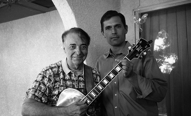 Michael Anthony and Senator Martin Heinrich (he was Congressman at time of this photo) -- August 21, 2o10 -- My wife & her friend Peg had organized a campaign fundraiser for Martin and held it at Peg's house in Albuquerque and they hired Michael to play guitar (Martin played us a song, too) -- photo by Mark Weber -------- Michael will celebrate his birthday with us on-air February 23 and he's bringing his guitar