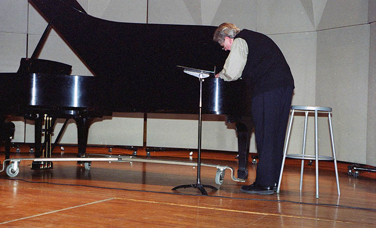 Gordon Mumma preparing the piano for the recital of his music at Keller Hall, University of New Mexico -- April 1, 2008 -- photo by Mark Weber