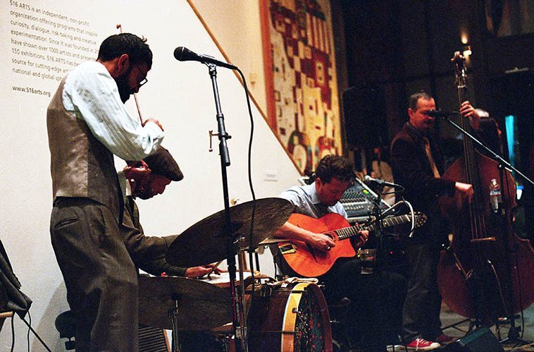 Every town has a Django gypsy band these days and Albuquerque has an exceptional one in Le Chat Lunatique: Muni Kulasignhe(violin), John Sandlin(guitar), Jared Putnam(bass), Fernando Garavito(drums) -- photo by Mark Weber -- Here they are knocking it out of the park for a gallery opening at 516 Arts, Albuquerque -- October 15, 2o16