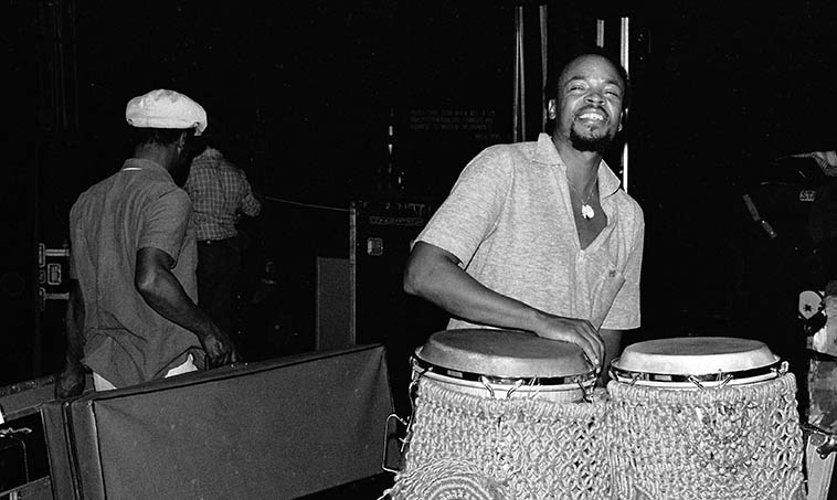 Don Moye and the Art Ensemble of Chicago setting up at Schoenberg Hall, UCLA (Roscoe carrying saxophone case) -- October 20, 1979 -- photo by Mark Weber