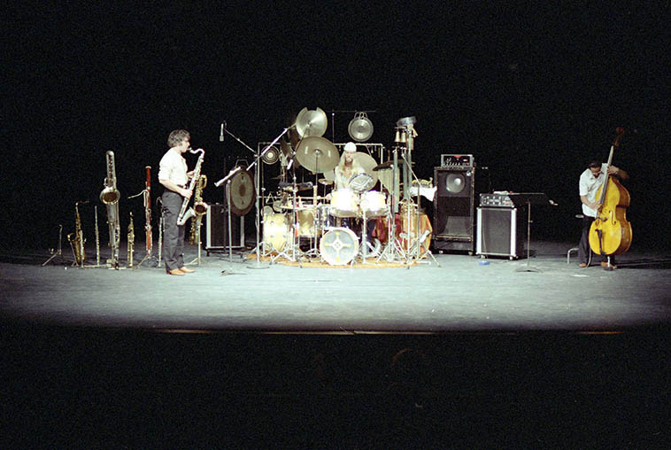 The Vinny Golia Trio -- January 20, 1980 -- University of California at Irvine -- Vinny (woodwinds), Alex Cline (trapset), Roberto Miranda (bass) ---- Vinny's core group during these years, opening for the World Saxophone Quartet this evening -- photo by Mark Weber