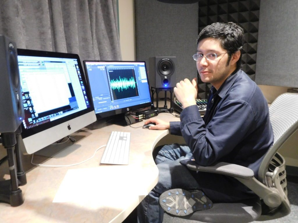 KUNM Production engineer Roman Garcia in Studio D (we have 3 production studios plus a larger room, Studio A, for recording bands) ---- We use Abobe Audition for music editing -- photo by Mark Weber -- March 3, 2o17