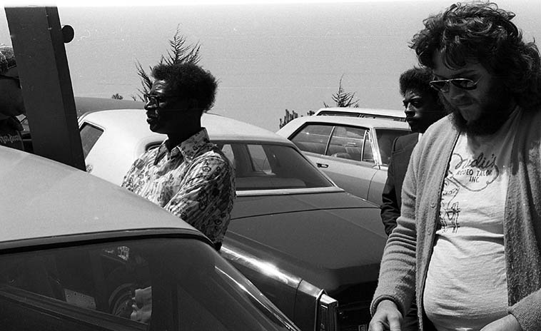 Who would zero in and track down a diddley bow player but KUNM's Friday jazz host John Breckow — That's Willie Joe Duncan, who called his one-string instrument a unitar, and John after interviewing Willie Joe at the San Francisco Blues Festival — August 14, 1977 — photo by Mark Weber