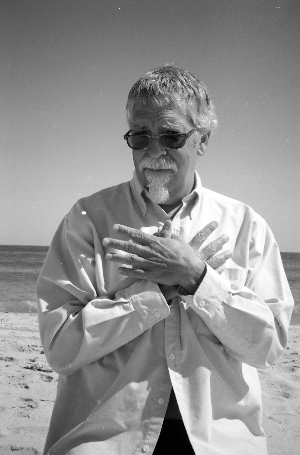 Mark Weber demonstrates Garuda mudra ---- July 10, 2oo9 Flying Point Beach -- snap by Janet ---- Garuda is the huge savior bird of Hindu mythology who removes all evil