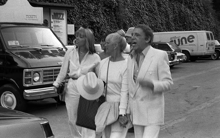 "Buddy Rich arrives at Playboy Jazz Festival, Hollywood Bowl -- June 21, 1980 -- photo by Mark Weber ---- One of my favorite Buddy Rich stories comes from David Parlato, who, along around 1968 he got the call to sub one weekend with Buddy's band at the Carousel in Covina, California (remember that place you Angelenos?) (it was right off the San Bernardino Freeway) Anyway, David's all set up with his bass next to the drumkit and they're about ready to hit and Buddy comes out, and sits down at the drums and says to David, ""Don't keep it a secret, kid."""