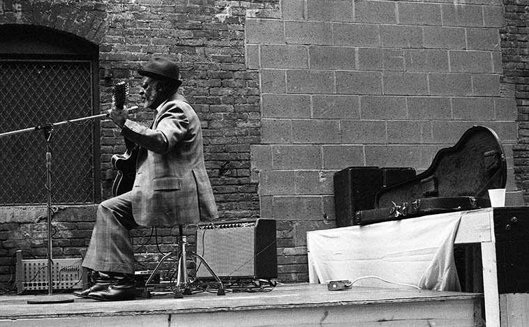 Robert Jr Lockwood -- playing his 12-string in an alley in the Warehouse District, downtown Cleveland -- May 16, 1987 -- photo by Mark Weber ---- the latest issue of LIVING BLUES has a smoking good piece of investigative journalism on the origins of Robert Jr's step-father Robert Johnson's devil at the crossroads mythology, I can't stress enough what a great magazine this is, we subscribe