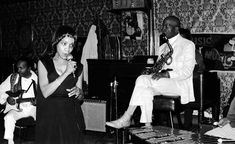 "Barbara Wells sitting on a Saturday night at The Rubaiyat Room, 1400 S. Western Avenue, Los Angeles, with the Blevins Brothers & Eddie Cleanhead Vinson -- Leo Blevins, guitar (who you can hear on the Beehive sessions of Max Roach & Clifford Brown) -- March 5, 1977 -- photo by Mark Weber ---- That was one of the beautiful things about clubs in South Central L.A. those years, was that the working bands let folks from the neighborhood sit in, many is the time a family at a table would push their mother or grandmother on stage to sing one, always good fun, and almost always quite good, no complaints from my table (Note: the 1400 block of Western Avenue is not technically in ""South Central"" as it is a few blocks north of the I-10 freeway)"