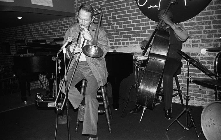 "Jimmy Knepper with the Joe Albany Quartet at The Lighthouse Cafe, Hermosa Beach, California -- December 3, 1981 with Leroy Vinnegar(bass) and Donald Bailey(drums) -- photo by Mark Weber -- Jimmy Knepper (1927-2003) was born and grew up in L.A. not far from the Hi-De-Ho Club where Charlie Parker had a gig March 1 - 13, 1947) and was part of the young scholars that followed Charlie around on the Coast, and as the story goes he and Dean Benedetti would transcribe Bird's solos, and according to Phil Schaap's thoroughly engrossing scholarly notes on the recordings from that club (emphasis on ""thoroughly""), Dean had a band that included both Joe Albany and Jimmy Knepper at that time ---- See booklet for Mosaic's box COMPLETE DEAN BENEDETTI RECORDINGS OF CHARLIE PARKER (1990)"