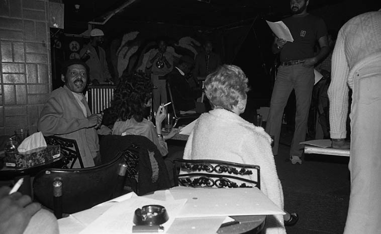 "I'd get my camera ready and then give a shout ""Hey, Ernie"" and when he turned around I snapped ---- Ernie Andrews at Maiden Voyage, downtown L.A. watching a Harold Land group rehearse for gig that night -- January 25, 1982 -- photo by Mark Weber ----- Maybe we'll listen (again!) to his version of ""On Broadway"" which just kills me, Ernie Andrews is a great jazz singer"
