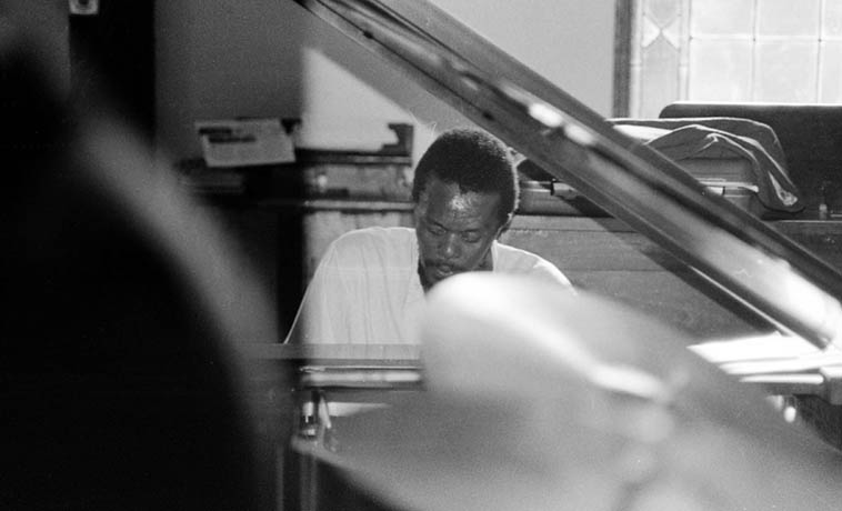 Horace Tapscott shot over the top of Billy Hinton's drums -- that's a grand piano so this photo was taken between February - June 1979 when Tom Albach rented the piano for the 6 Sundays he recorded at I.U.C.C. church in Los Angeles -- photo by Mark Weber (normally the church had a spinet)