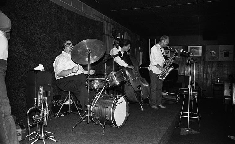 Don Menza Quintet -- Dick Berk(drums), Frank DeLaRosa(bass), Don Menza(tenor & flute), Chuck Findley(trumpet & flugel), Frank Strazzeri(piano) -- 40 miles east of L.A. at a little joint on Rt.66 in Cucamonga called Gilberto's that had Sunday afternoon jazz -- June 14, 1981 -- photo by Mark Weber