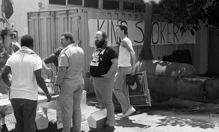 King Smoker it says: That's bassist/composer Al Hines (in the very center) getting himself some ribs at Watts Towers Jazz Festival -- July 15, 1984 ---- AND that's the inimitable Dwain Kaiser standing behind Al waiting for some ribs, also (Dwain had the bookstore Magic Door in my hometown of Upland -- he is a scholar of Science Fiction and a union organizer and a poker player, he was part of my crew, Horace Tapscott always loved when I brought Dwain around, they both being very politically-oriented) ---- photo by Mark Weber