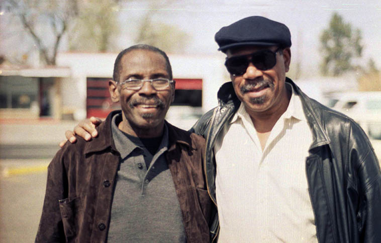 George Cables and Sonny Fortune in Albuquerque outside the Farmer's Market on Coal -- I was driving them around on their day off on tour with Frank Morgan -- March 24, 2003 -- photo by Mark Weber -- George Cables needs your help