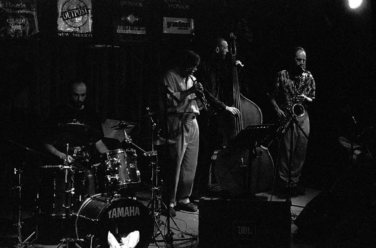 The Joseph Salack - Dan Pearlman Quartet -- November 11, 1996 ---- out of Taos, New Mexico, playing the old Outpost: Dan Pearlman(cornet), Joseph Salack(bass), Raymond Blanchet(tenor), Lee Steck(drums) -- photo by Mark Weber -------- Dan Pearlman is the lyrical horn with Dave Wayne's current band > OrnEtc.