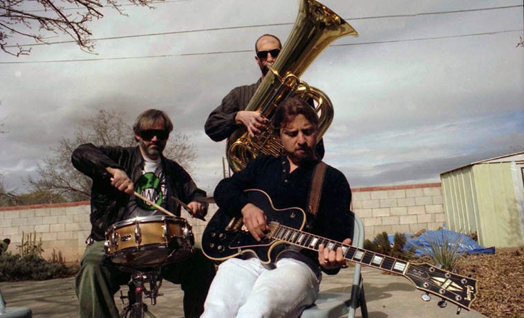 A trio calling themselves Protuberance -- worked around Albuquerque most of the 90s, first as a duet, then a trio, made one fantastic record for Zerx Records: Dave Wayne(drums), Mark Weaver(tuba), Paul Pulaski(guitar) -- February 8, 1998 -- photo by Mark Weber ------ Dave Wayne will be visiting the Thursday jazz show on April 26 to bring us up to speed on what he's been up to lately
