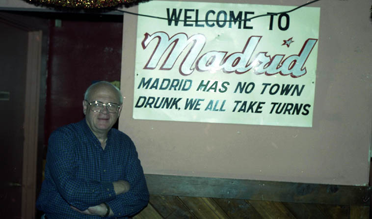 We sure miss Todd Moore on the Thursday jazz show -- He could put the shadow into Noir Jazz (here's one of his poems) ---- Madrid is an abandoned mining town on the other side of the mountains from Albuquerque where Sixties people took over and re-built and settled, there's quite a scene there nowadays ----- This sign is at The Mine Shaft bar & grill and says: Madrid has no town drunk . . . . . . . Photo by Mark Weber -- February 20, 1998 (Todd got away from us back in 2o10)