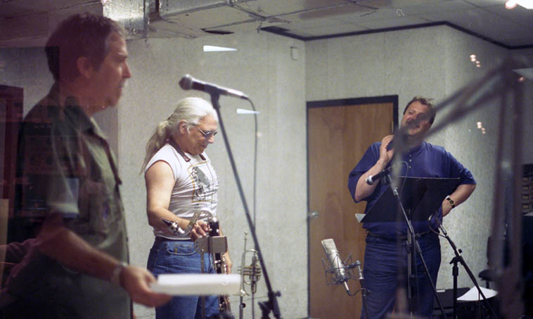 At the tail-end of this Live broadcast over KUNM Mr Blakeslee had motioned to me to come out of the control room and read a poem or two to fill out the hour ---- I had performed with them before on a few other occasions, out in L.A. and here in New Mex, so it was smooth sailing with my homies: Vinny Golia(woodwinds), Rob Blakeslee(trumpet), Billy Mintz(drums), Ken Filiano(bass), Simon Welter(engineer) -- surprise photos by Rob Kellar as I'd left my camera laying in the control room -- May 24, 1997 ----- You'd think I'd be more recognized for poetry (it's what I do), when Connie Crothers called from NYC distraught that she had just read a book review of an Anthology of Poetry in New Mexico 1960-Present and found that I wasn't in it, and wondered why, I told her that I hang around jazz musicians so am not known to the poetry establishment and I don't think poets listen to jazz (Todd was left out, too, but that was probably because his poetry is too scary)