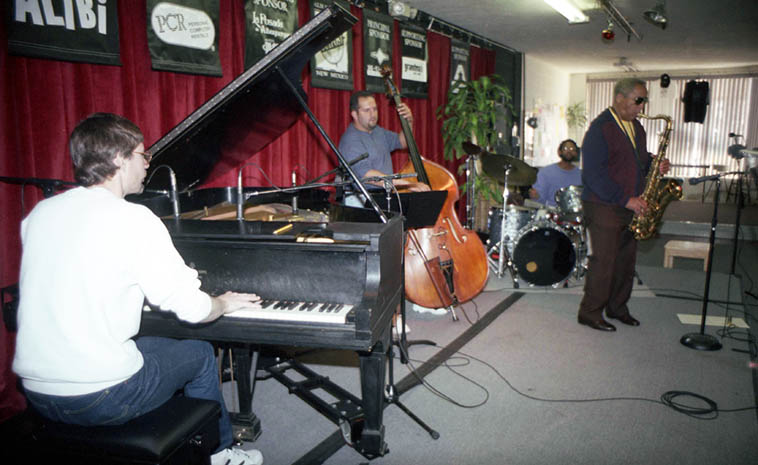"Von Freeman rehearsal with local hotshots: Bert Dalton(piano), Rickey Malachi(drums), John Belzaguy (bass) -- gig that night at Outpost -- December 13, 1996 ----------- That evening I went to pick up Vonski from his hotel to bring him to gig but he wasn't downstairs as arranged, so I called up to his room, and later when he came down he apologized, ""Geez, Markski, I was so asleep I was UNDER the bed!"" ---- photo by Mark Weber"