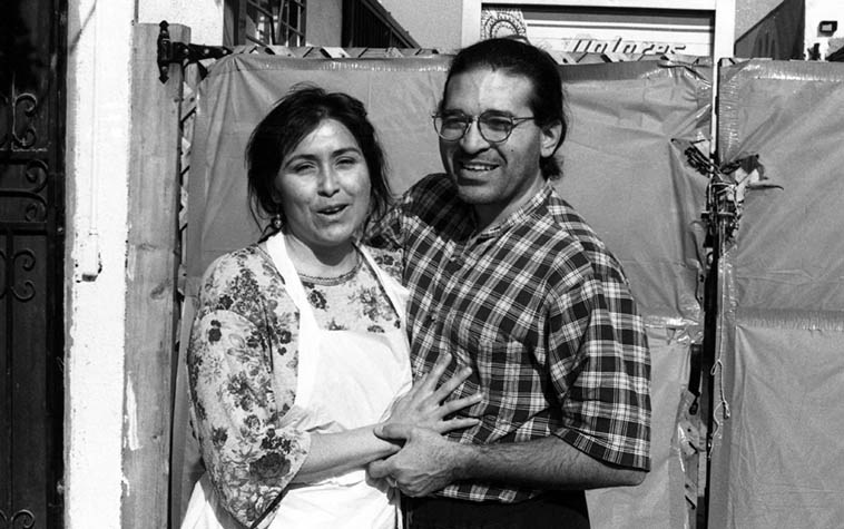 Chris Garcia and his wife Yolanda at Juanito's Tamales in East L.A. — December 22, 1995 —- They owned Juanito's those years and Yolanda was working long hours to get the Christmas tamales ready in abundance because in Los Angeles that's what we do at that time of year: Eat lots of Christmas tamales — photo by Mark Weber -- (Chris is drummer with the Grande Mothers, Michael Vlatkovich, Bobby Bradford Mo'tet, Quartetto Nuevo, de man ia w/Alex deGrassi & Michael Manring, etcetera & etc)