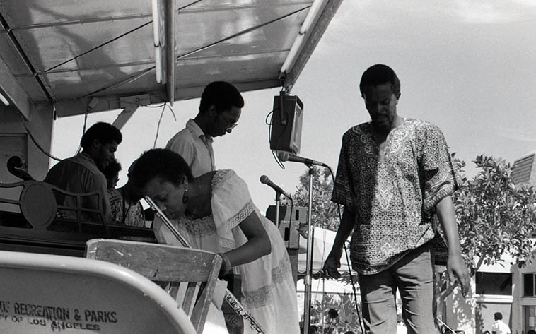 Adele Sebastian(flute) who was very special, here with the Pan Afrikan People's Arkestra (that's the other flutist in the Arkestra behind her: Aubrey Hart, and conductor/pianist Horace Tapscott -- July 7, 1979 Watts Towers Jazz Festival -- photo by Mark Weber
