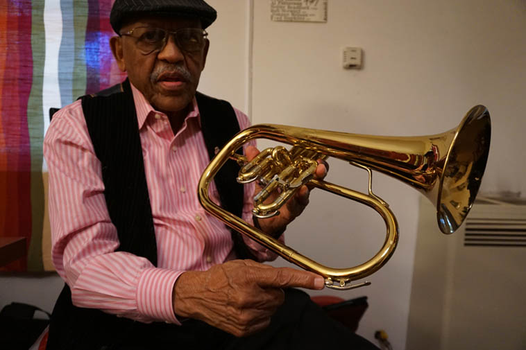 "Bobby Bradford and his 1970s Getzen flugelhorn he just bought off EBay and is still putting it through its paces to see if it will do what he needs ----- In his studio -- June 15, 2o18 before driving down to L.A. County Museum of Art ( ""LACMA"" in LAspeak) for gig with his Mo'tet -- photo by Mark Weber"