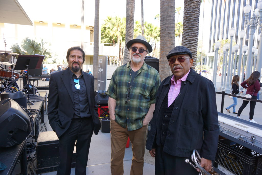 Bobby Bradford with his drummer Yayo Morales and pianist Theo Saunders at LACMA before the concert Friday June 15, 2o18 Los Angeles -- photo by Mark Weber ------- Yayo was born in Bolivia and spent his first 20 years there, then to Madrid for 23-some years, and now he's in L.A. and Henry Franklin brought him to Bobby's attention ----- Theo has been knocking about L.A. jazz scene for decades . . . . . . . .