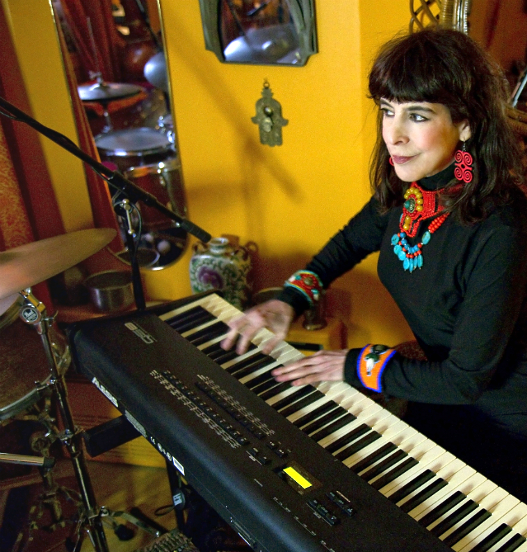 Kali Z Fasteau playing synthesizer in her Harlem apartment, January, 2017. Photographer: Crystal Blake