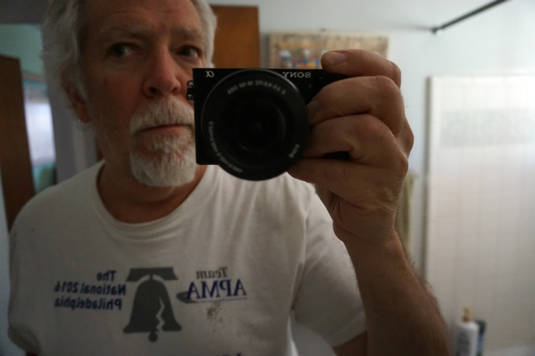 Self-portrait with new camera in mirror – June 4, 2o18 – photo by MW
