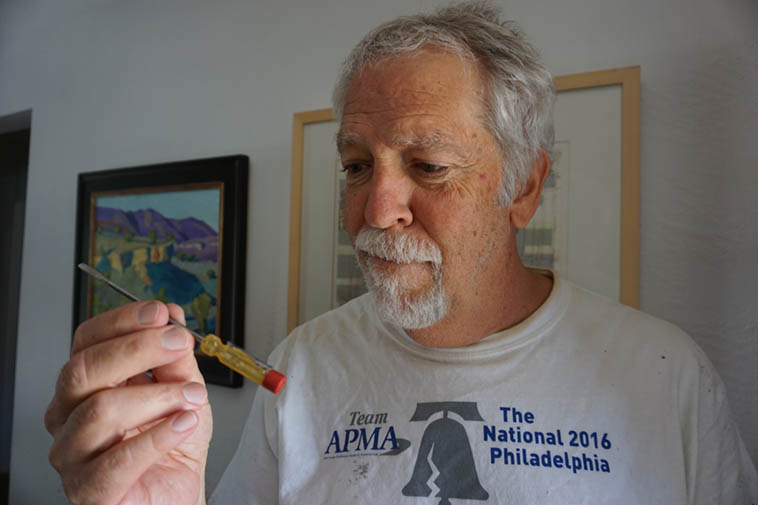 That's me pondering a screwdriver (Craftsman, obviously) that my Uncle Jack gave me when I was 5 to work on my Erector Set ---- I still use that tool, works great removing set screws in bathroom fixtures (we're remodeling our master bath) – photo by Janet at 725 on Sept 1