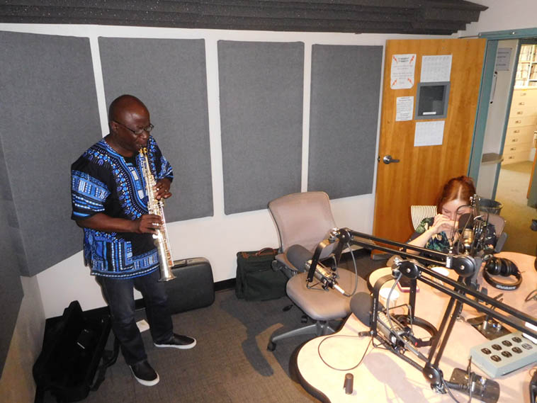 Sam Newsome laying it down over New Mexico jazz airwaves while his wife composer/violinist Meg Okura listens – August 10, 2o17 ---- photo by Mark Weber