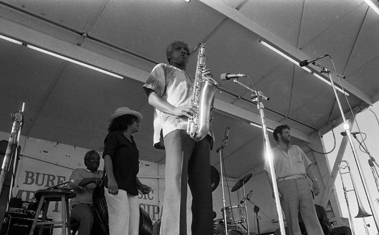 Teddy Edwards Sextet at Watts Towers Jazz Festival – July 5, 1980 w/ Clora Bryant(trumpet), Leroy Vinnegar(bass), Clarence Johnston(drums), Fred Carter(trombone), Teddy(tenor), Art Hillary(piano) ------ photo by Mark Weber
