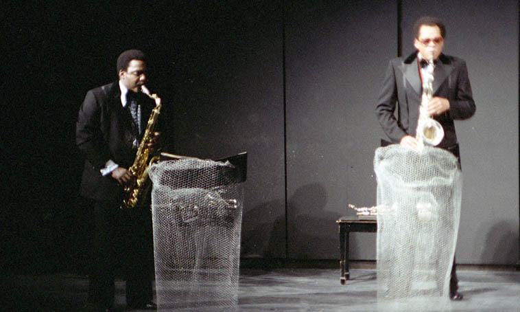 Half of World Saxophone Quartet – David Murray and Julius Hemphill AND those crazy chicken wire music stands that Julius had made that afternoon before the concert on a double-bill with Vinny Golia Trio at U.C. Irvine – January 20, 1980 – photo by Mark Weber
