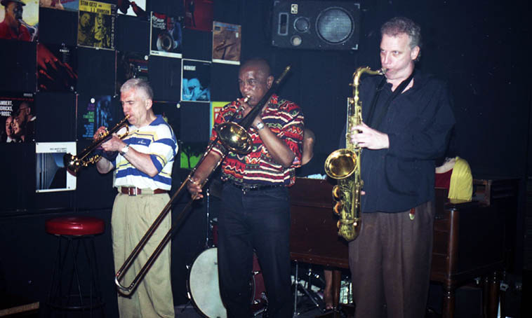 Doug Lawrence jam session in Hell's Kitchen: The Savoy Bar, 9th Ave & 41st Street NYC ---- June 28, 1997 --- We'd just got off the plane and jumped down here for this late-night jam ---- Valerie Ponomarev(trumpet), Dick Griffin(trombone), Doug(tenor) ----photo by Mark Weber