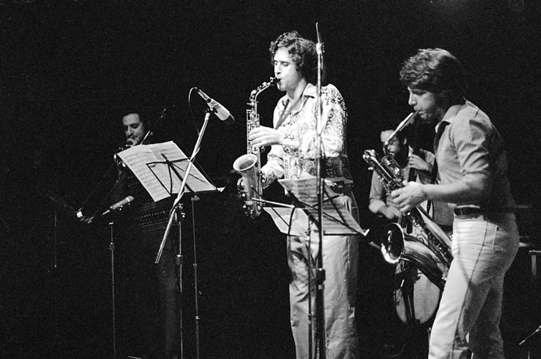 "I don't remember VAT! No drums? This looks like a variation on the band formed for Tim by my brother Alex for his first recording, ""The Five Year Plan"". Of course everyone looks so young here because they were! Glenn Ferris moved to Paris not long after this and continues to play amazing trombone as far as I am aware. An amazing guy in all ways and a monster trombonist who had played a lot with Bobby Bradford, Frank Zappa, et al. Vinny bringing the power to the baritone saxophone... I wrote a song dedicated to him on my first record, ""Angelica"", called ""The Lung"", an appellation inspired by his immense lung power. Sorry that I don't recall this concert, though! ---- October 28, 1979 photo by Mark Weber (the drummer on this date was Alex Cline)"