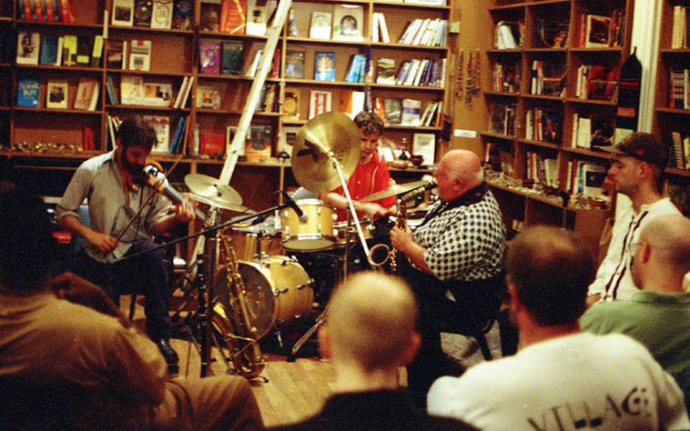 Joe Maneri Trio with his son Matt on electric six string violin and Randy Peterson, drumset, at Biblios, a bookstore on SoHo, NYC – June 28, 1997 ----- photo by Mark Weber