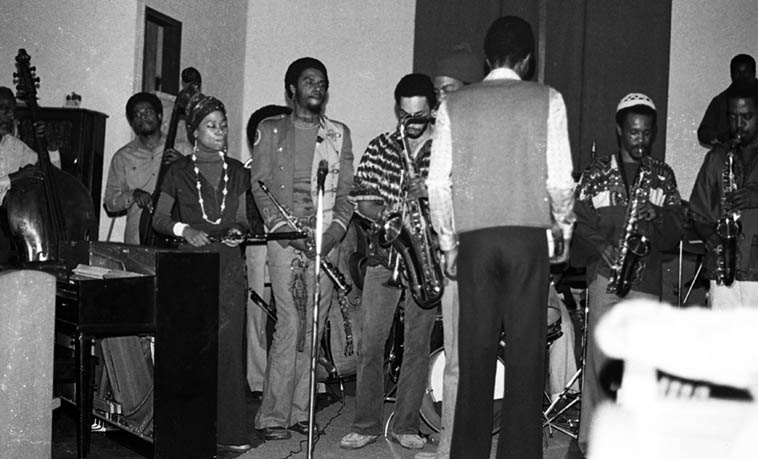 Pan Afrikan Peoples Arkestra under direction of Horace Tapscott ---- January 30, 1977 @ I.U.C.C., Los Angeles --- I see David Bryant(bass), Adele Sebastian(flute), Jesse Sharps(with macramé weaving dangling from soprano saxophone), Steve Smith(trpt), Arthur Wells(alto), Michael Sessions(alto) ------ photo by Mark Weber