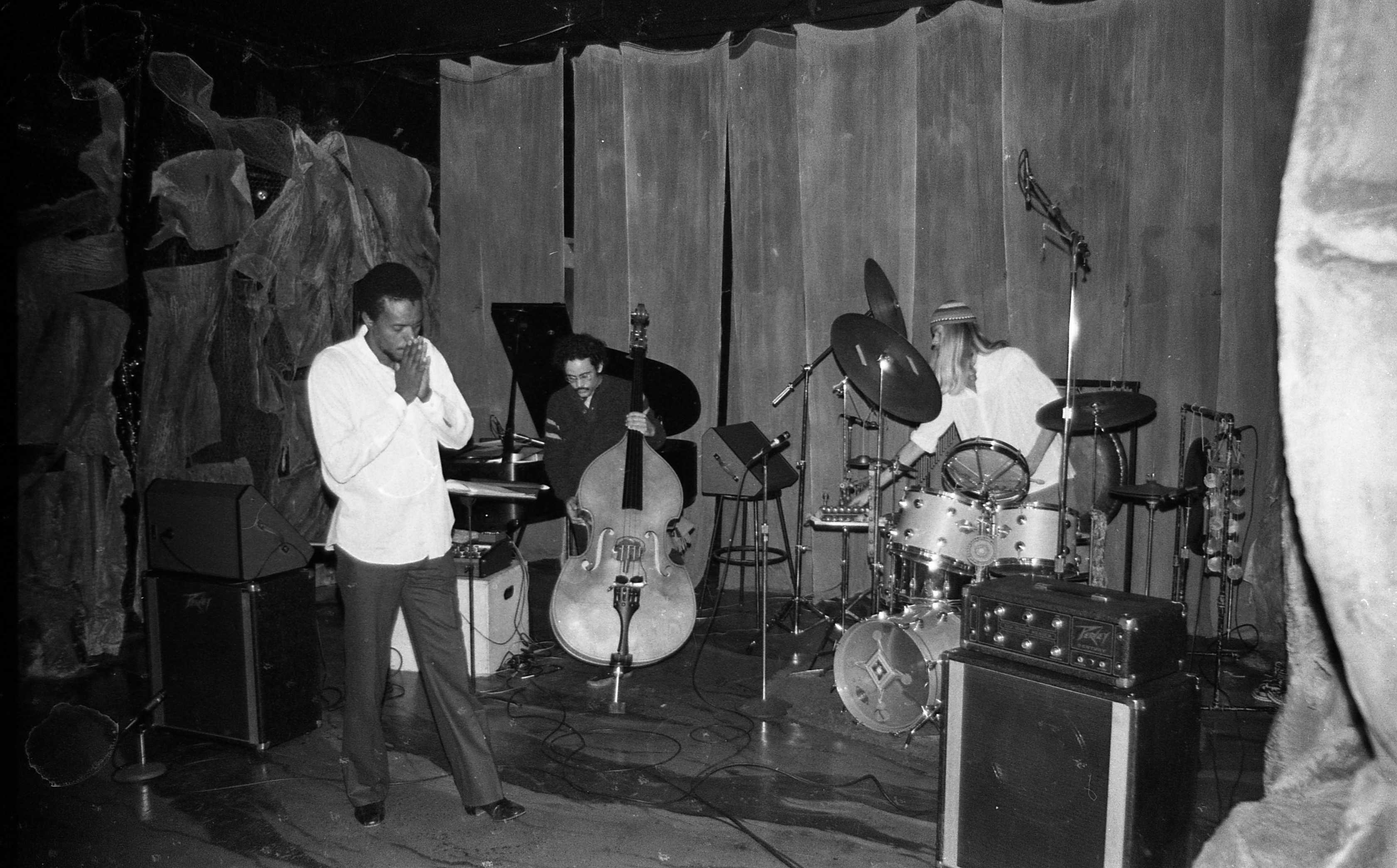 Horace.... This trio -- a brief moment - was quite SMOKIN', I think. It was so amazing to Alex and to me that this ever happened: Horace Tapscott with Roberto Miranda (who played with Horace for years and years) and my longhair brother Alex... I think that Peavey amp right in front on the right was Roberto's wacky bass rig at the time, set up way far away from him. Roberto had many eccentricities... Horace is a bit difficult to describe/explain to those who nothing about him (which may be more people than I care to think about). His regular concerts with the Pan-Afrikan Peoples Arkestra (please check my spelling) had a scope and significance beyond music. But musically speaking, it nurtured the talents of so many musicians, many of whom really stood out and the most famous of whom was Arthur Blythe. But Jesse Sharps, Fritz Wise, Donald Dean, Adele Sebastian (someday I suppose someone should write something about this talented and charismatic young flutist who died so young - a truly beautiful human)...a lot of wonderful players. Horace was like royalty or something. We were in awe of him. His earlier stance was pretty intense and a little fearsome, but he was really one of the warmest people, and he really represented art/jazz, his community, and the dignity and power of an African-American. His presence was almost staggering, his playing knotty and unpredictable. He was a real leader. And he could disarm anyone with that smile of his and with his embrace. Alex and I attended his funeral, which was in a huge church with a huge crowd attending. And I don't want this to sound weird, but looking at him in the open casket lying in state with a fez on.... he looked like a king. Regal. Stunning. I guess I'll stop there. ----- photo by Mark Weber – February 10, 1980 Century City Playhouse