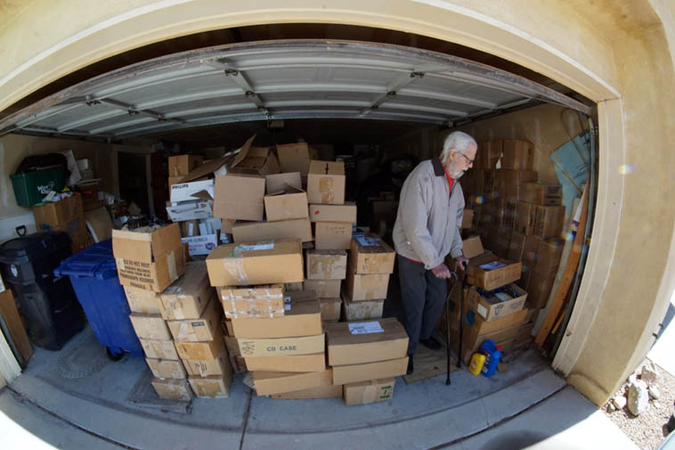 Tom Albach and his great achievement, that of documenting Horace Tapscott and the Pan Afrikan People's Arkestra in the 1980s ---- That's the Nimbus West warehouse stock of LPs and CDs in his garage here in Albuquerque ---- March 4, 2o19 photo by Mark Weber with an 8mm lens, digital