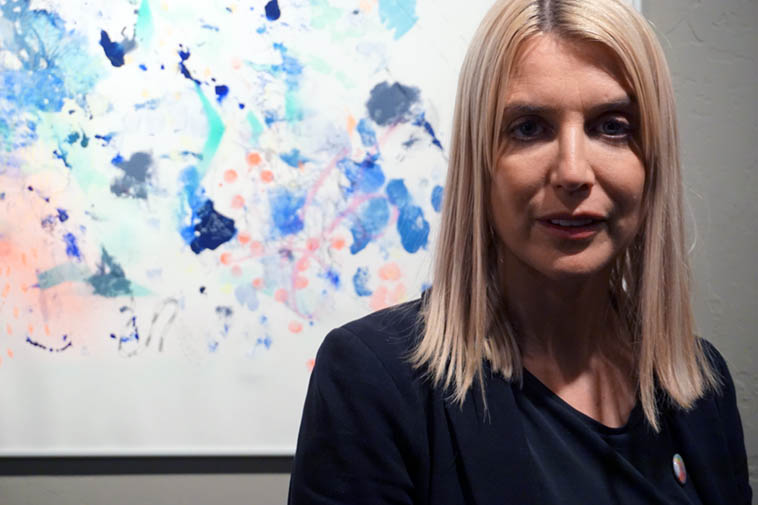 Isadora Stowe at her Adjacent Possible show of recent paintings ---- March 15, 2o19 @ Inpost Artspace, Albuquerque (aka Outpost) --- photo by Mark Weber ---- These are the kind of paintings you want to sit in front of, somewhat close, and let them seep in