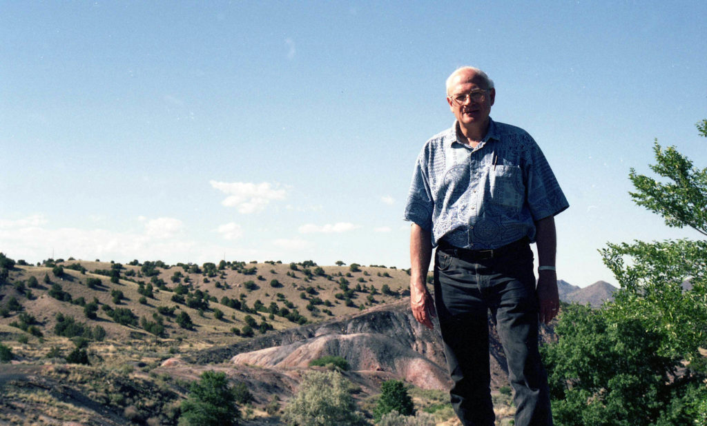 """Todd Moore in New Mexico badlands ---- May 29, 1994 ---- photo by Mark Weber ---- I was telling Todd why bother with poetry readings when only 12 people, a wino, and a dog show up? To which, Todd added philosophically, """"And the dog is drunk."""" Here's one of his poems:"""