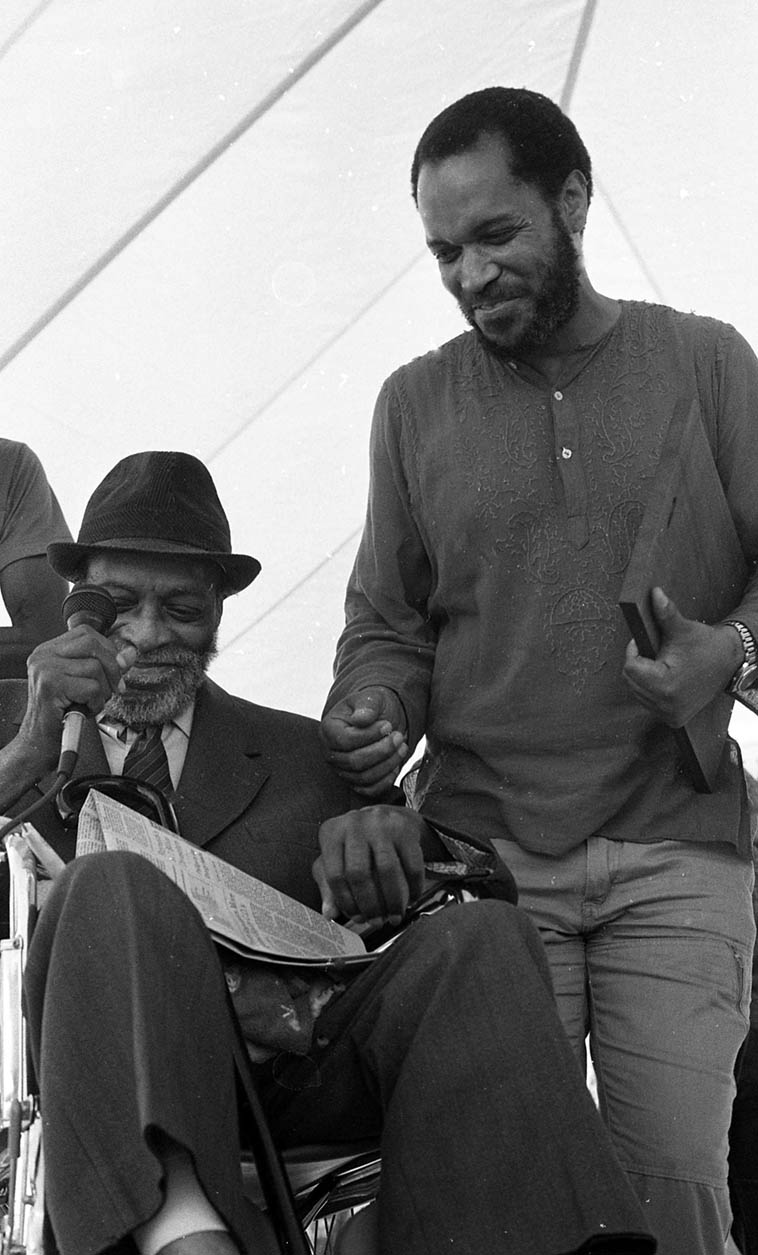 There's a lot of history and accomplishment in that photo: Papa Jo Jones receiving an award from Billy Higgins for his achievements in jazz at the 3rd annual Watts Towers Day of the Drum ---- September 23, 1984 – photo by Mark Weber