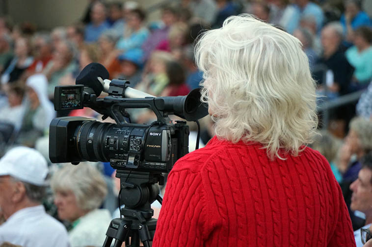Patty Patten at work ---- documenting the New Mexico jazz scene ---- June 22, 2o19 @ Albuquerque Museum Amphitheater ---- photo by Mark Weber