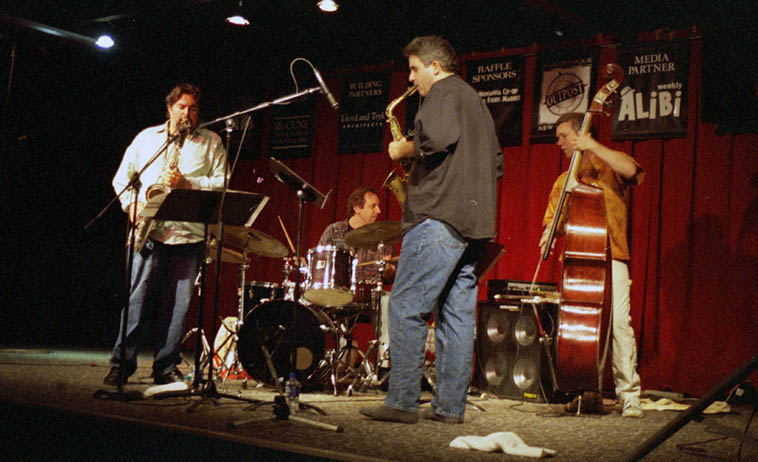 The Schulldogs at the Outpost Performance Space, Albuquerque ---- November 13, 2000 --- George Schuller(drums), Ed Schuller(bass), Tim Berne(alto), Tony Malaby(tenor) ---- photo by Mark Weber ------ George Schuller is bringing his group Circle Wide Quintet to Albuquerque next week playing the Route 66 Summerfest street party on July 20th AND on the 21st at the Outpost screening his documentary film The Modern Jazz Quartet: From Residency to Legacy(2o18)