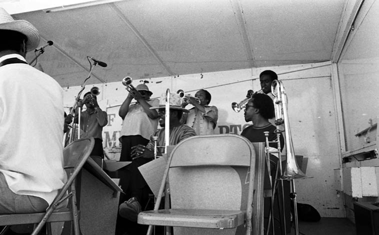 Check out Buddy Collette's trumpet section: Leslie Drayton, Bobby Bryant, Snooky Young, Al Aarons, while Charles Owens (extreme left), George Bohanon, and Maurice Spears look on ---- Watts Towers Jazz Festival – July 5, 1980 – photo by Mark Weber