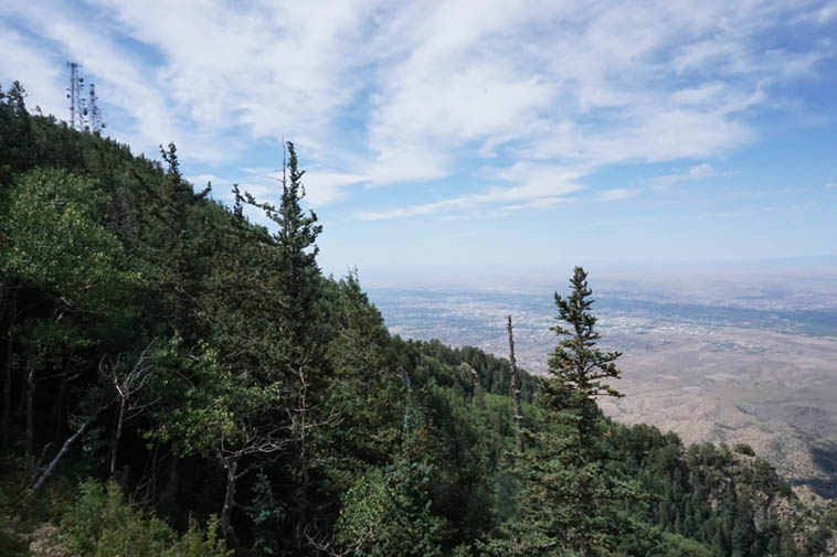 See those radio & television broadcast towers to the left? That's KUNM's signal shooting out over the state of New Mexico, and in this shot, that's Albuquerque, that dark swatch is the Rio Grande of yore ---- Sandia Crest ---- September 2, 2o19 --- photo by Mark Weber at 10,679 feet elevation