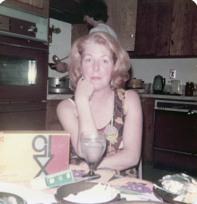 My Mom -- Joy Weber with her son Mark behind her ladling a bowl of chili -- Upland, California circa 1977